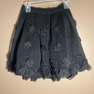 Bebe fishnet flower black skirt